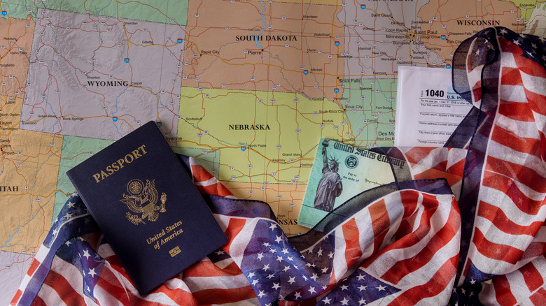passport and flag on top of map