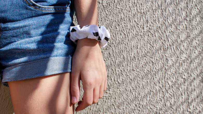 Woman with scrunchie on her wrist