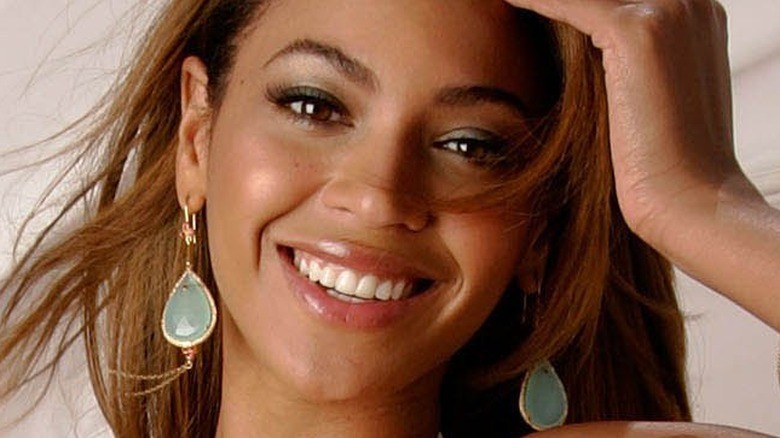 Beyonce smiling in a breeze