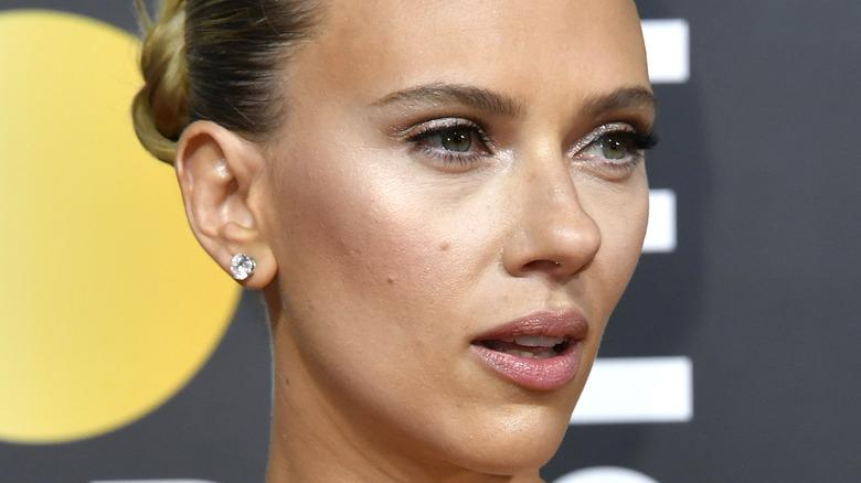 Scarlett Johansson wears her hair in a tight bun.