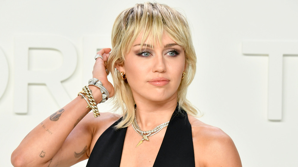 Miley Cyrus wears a mullet hairstyle