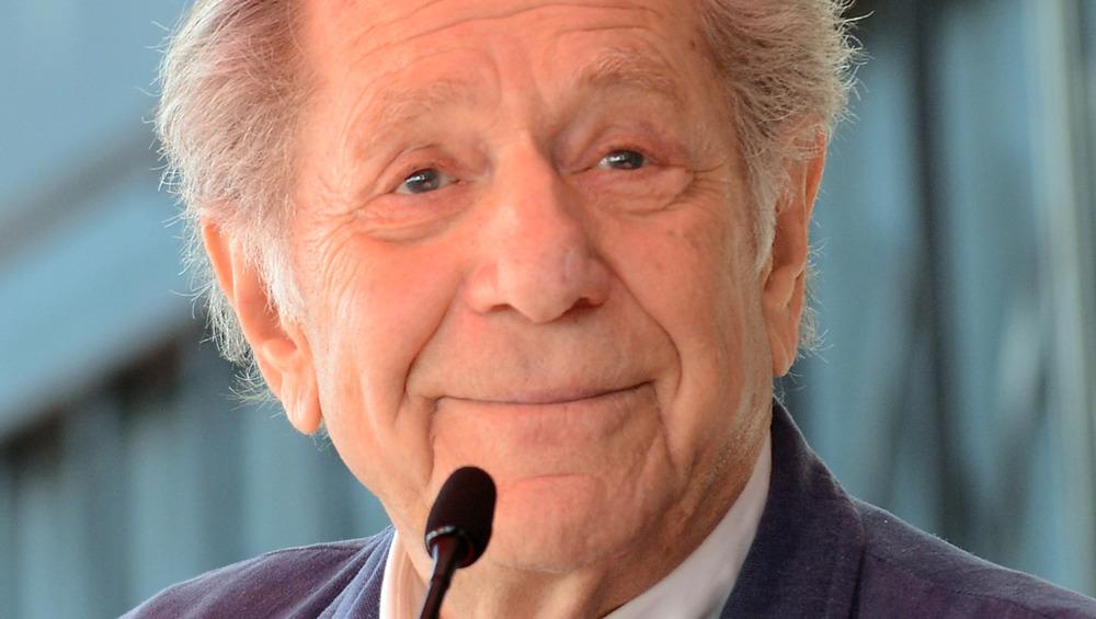 George Segal smiling at mic
