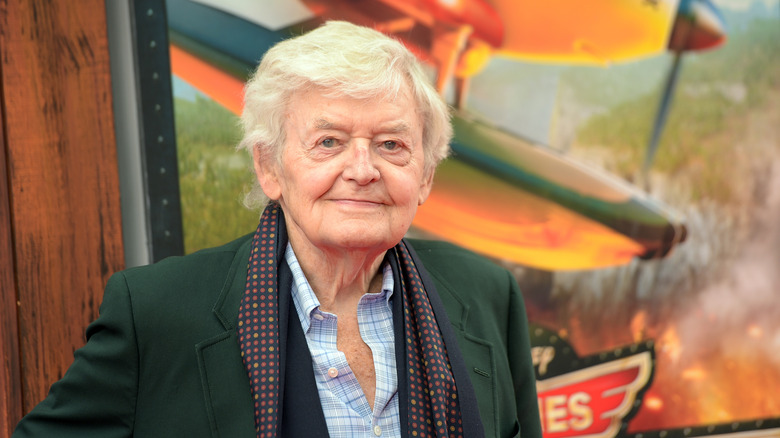 Hal Holbrook in green suit and scarf