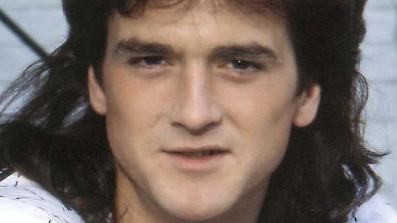 Les McKeown with long hair