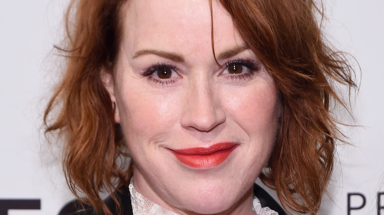 Molly Ringwald poses on the red carpet