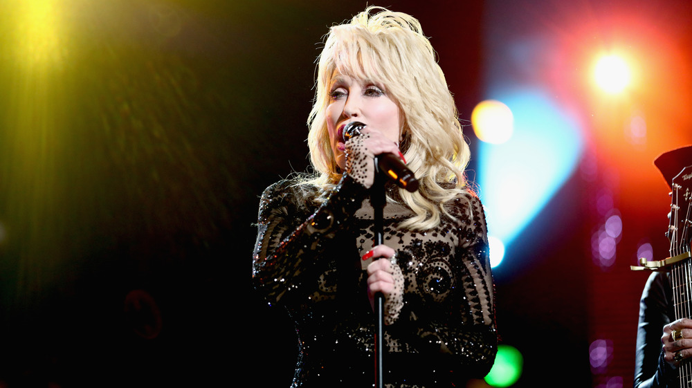 Dolly Parton performs in black top