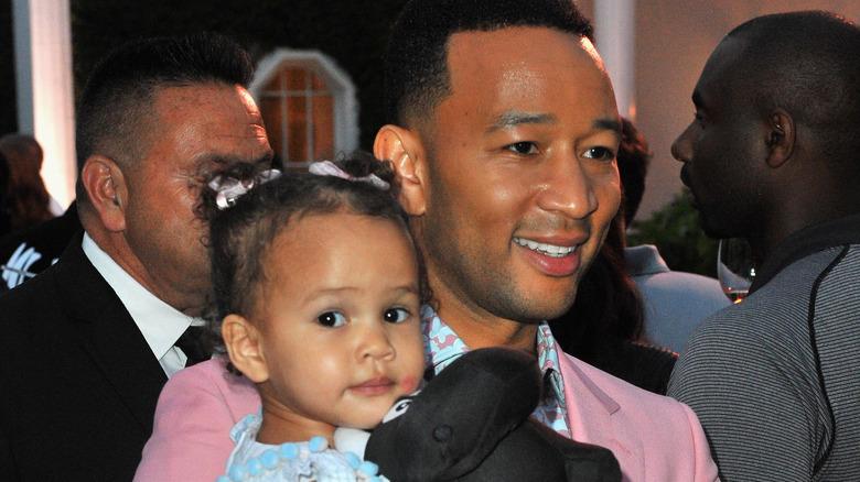 John Legend carrying his daughter Luna