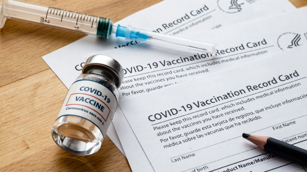 Vial of COVID-19 vaccine and syringe