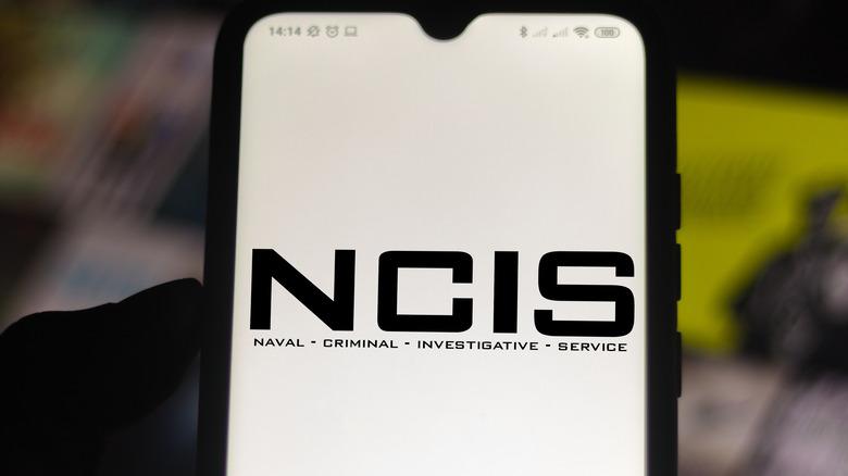 """NCIS"" logo on phone screen"