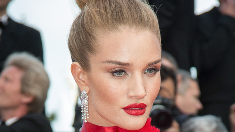 Rosie Huntington-Whiteley poses at an event