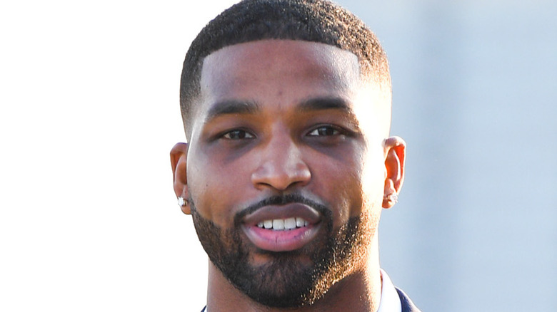 Tristan Thompson poses on the red carpet