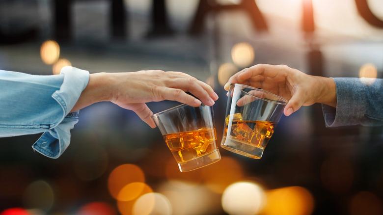 "bourbon on the rocks ""cheers"""