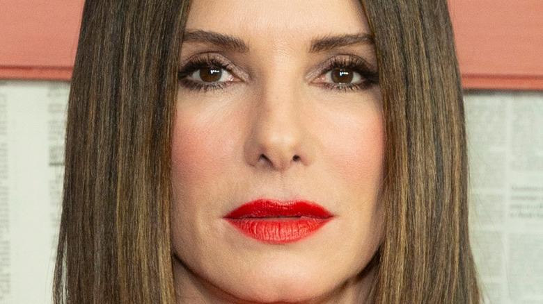 Sandra Bullock wears red lipstick and rocks a short bob.