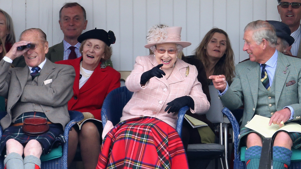 Queen Elizabeth sitting with Prince charles