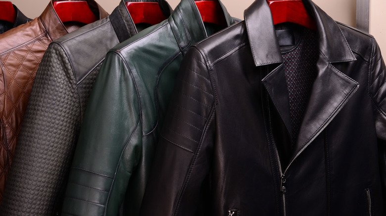 Leather jackets hanging in closet