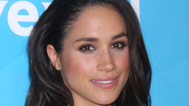 Meghan Markle poses with a smile.