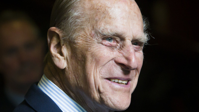 Prince Philip smiling in blue suit