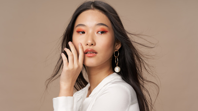 makeup trend, woman with orange eyeshadow