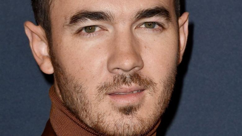 Kevin Jonas looking serious with facial hair