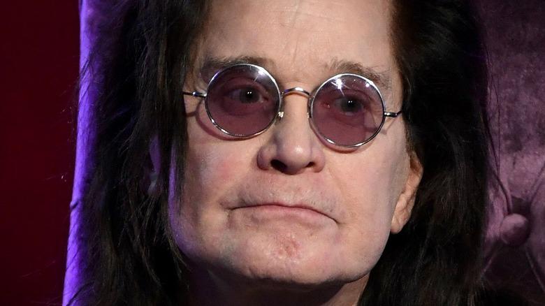 Ozzy Osbourne wearing glasses
