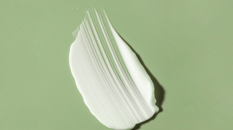 Lotion on green background