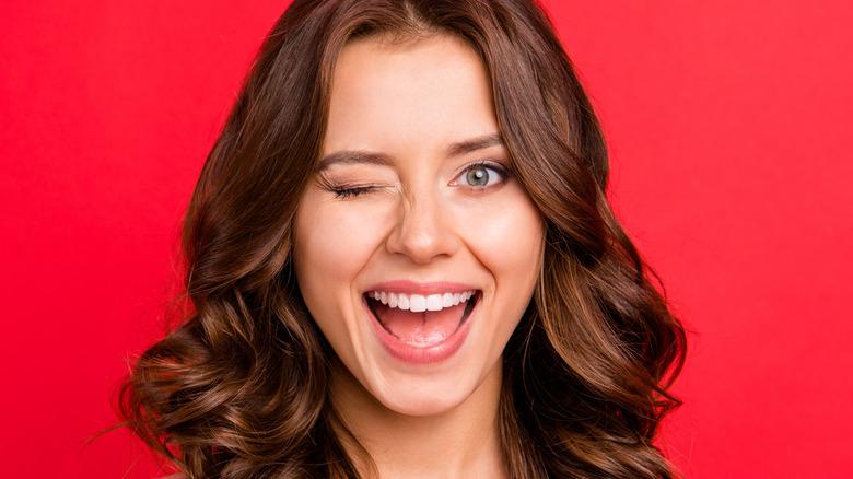 brunette woman winking