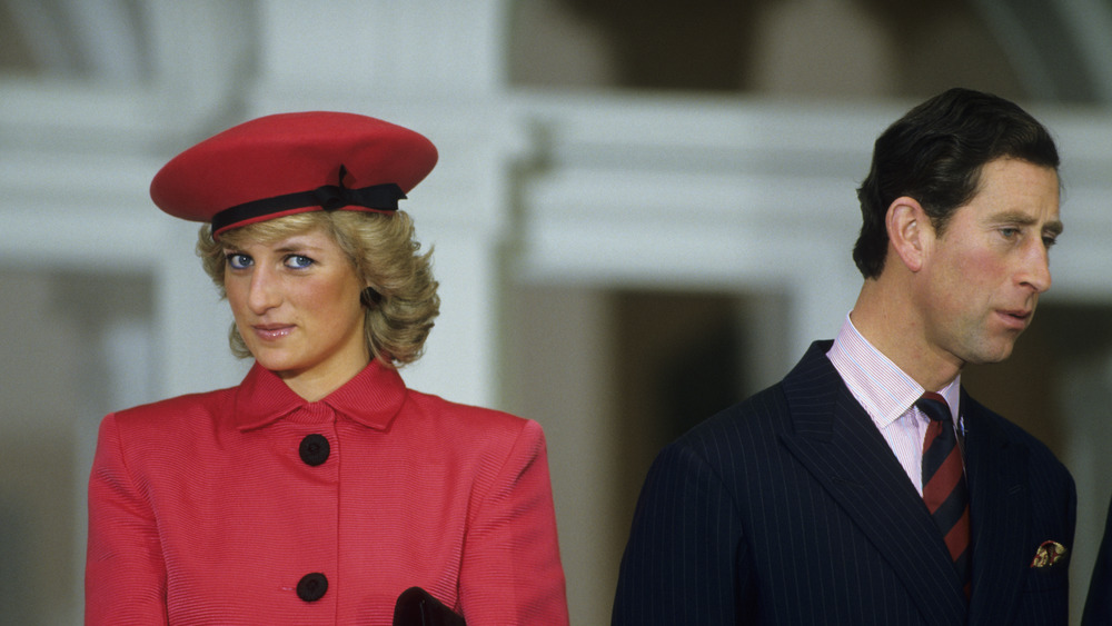 Diana Spencer and Prince Charles turning from each other