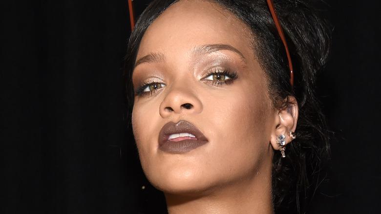 Rihanna at fashion show wearing sunglasses
