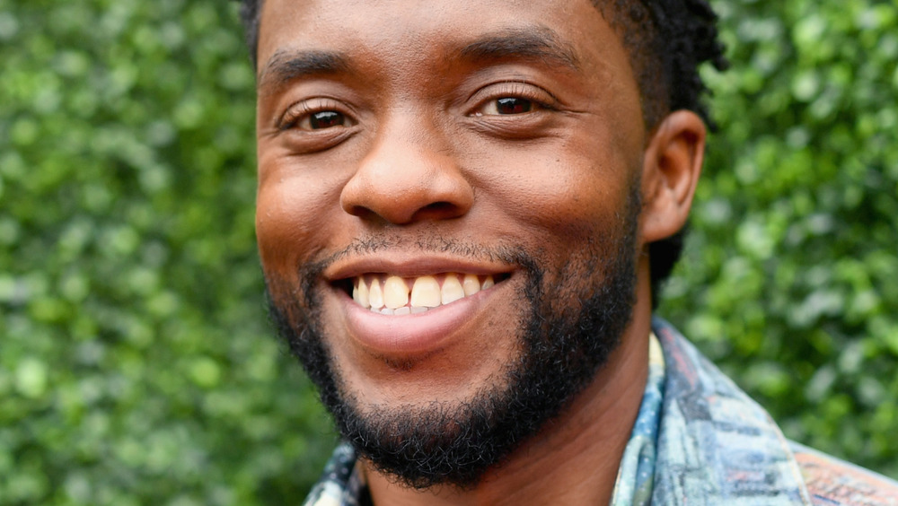 Chadwick Boseman smiling outside