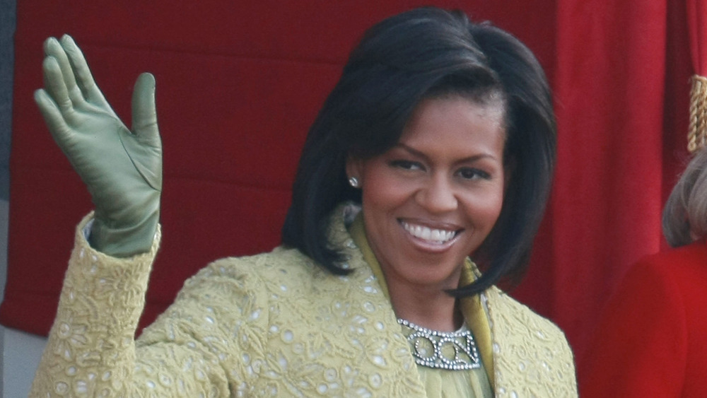 Michelle Obama waving to a crowd