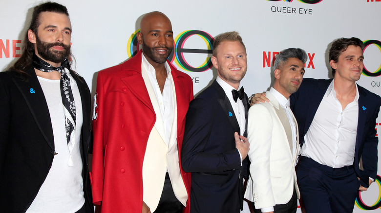 Queer Eye cohosts wearing suits