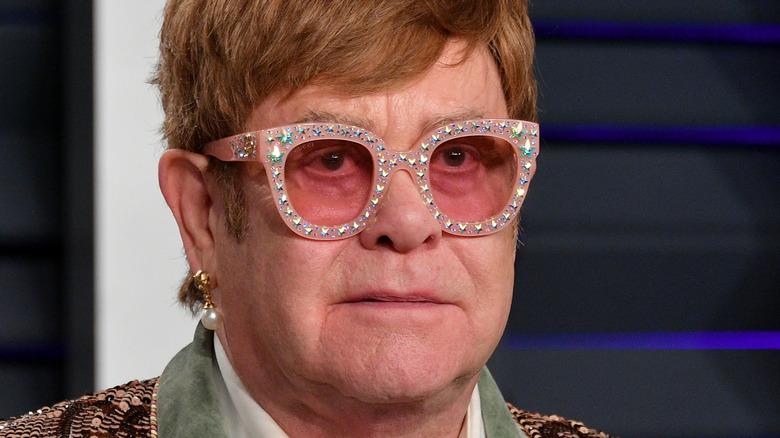 Elton John poses on the red carpet