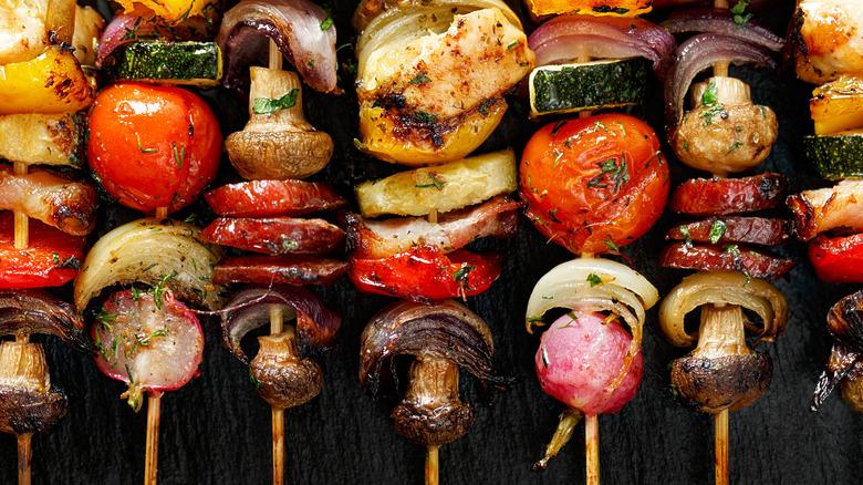 Skewers of grilled mushrooms and vegetables