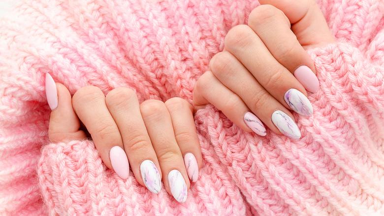 Pink sweater, pink nail polish