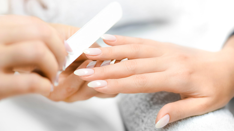 A woman getting a manicure