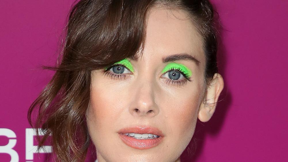 Actress Allison Brie wearing neon green eye shadow