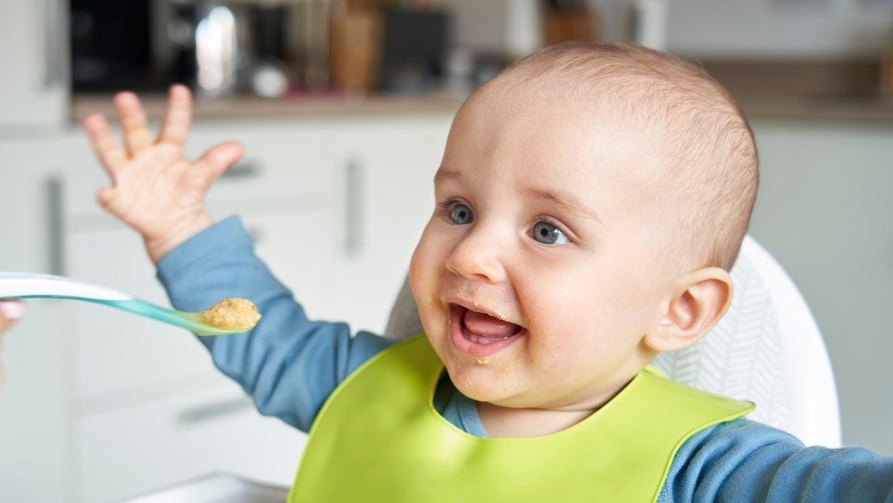 Feeding a happy baby