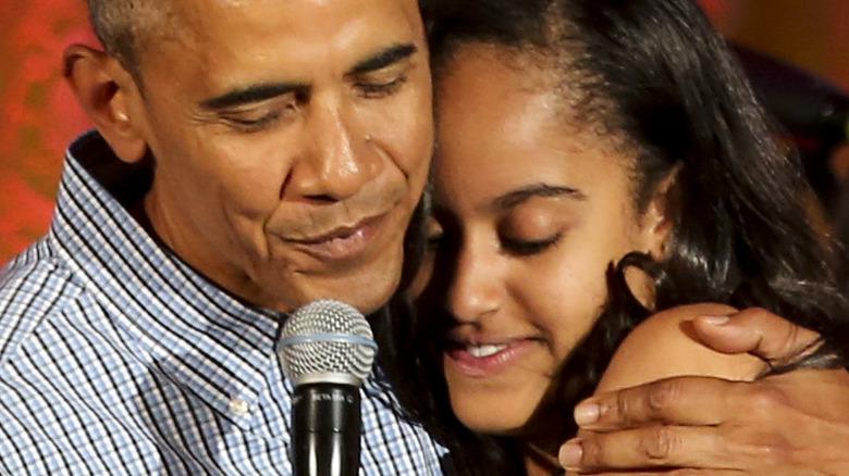 Barack Obama hugs Malia Obama