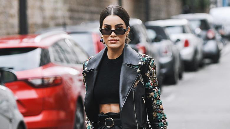 women wearing a midriff-baring street style outfit during Paris Fashion Week