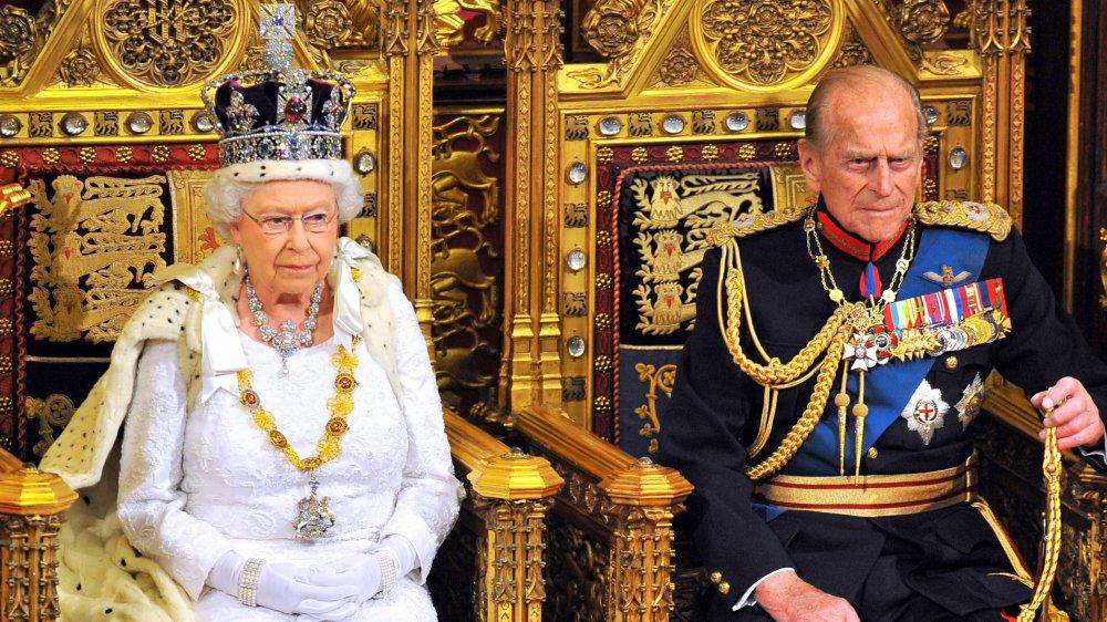 queen Elizabeth and prince Philip in state regalia