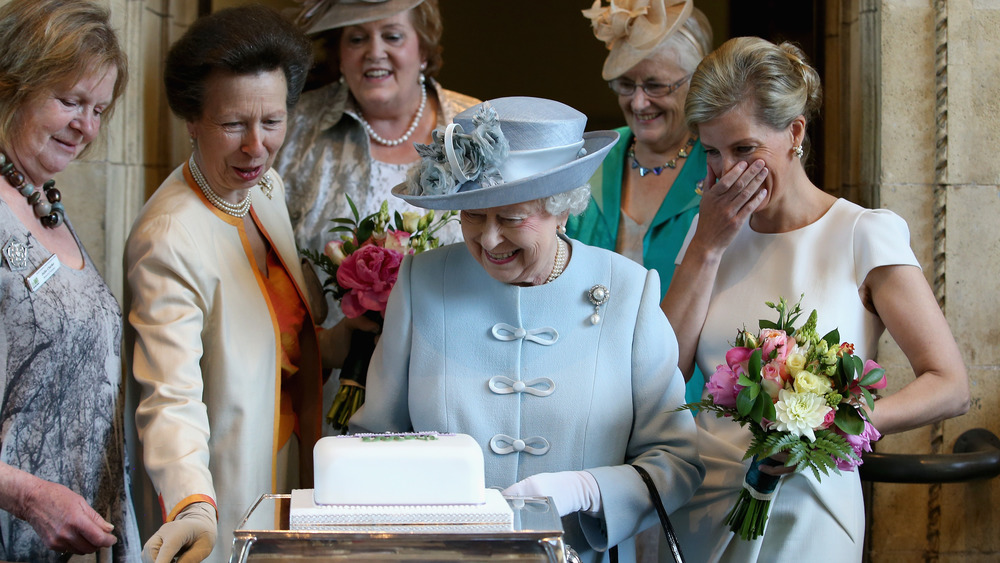 Queen Elizabeth II being presented with a cake by the Women's Institute