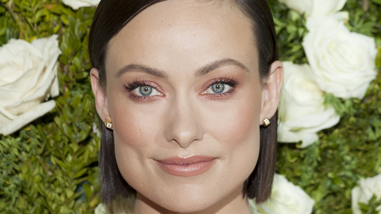 Olivia Wilde poses on the red carpet
