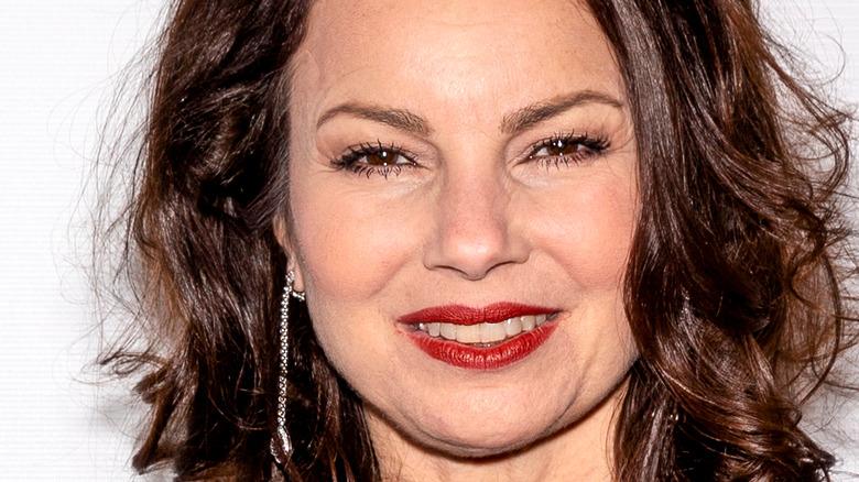 Fran Drescher smiling with red lip