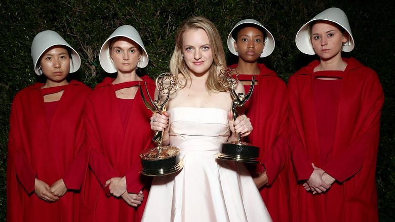 Elisabeth Moss at event holding awards