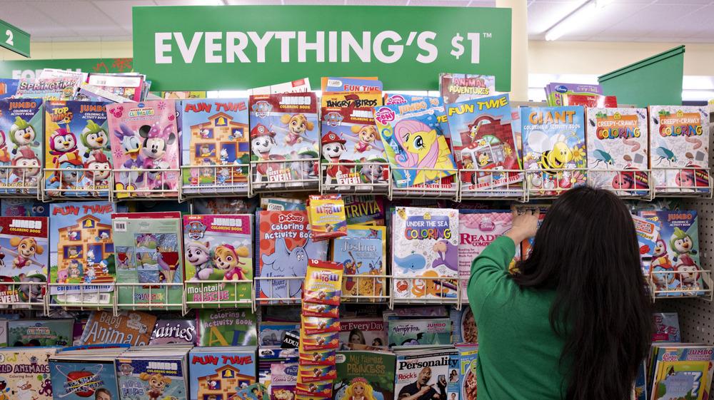 Dollar Tree employee stocks shelves