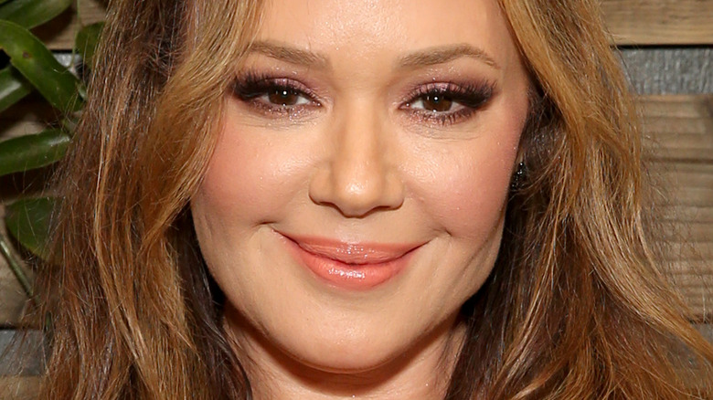 Leah Remini poses with her award