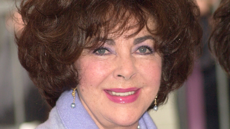 Elizabeth Taylor poses with a smile.
