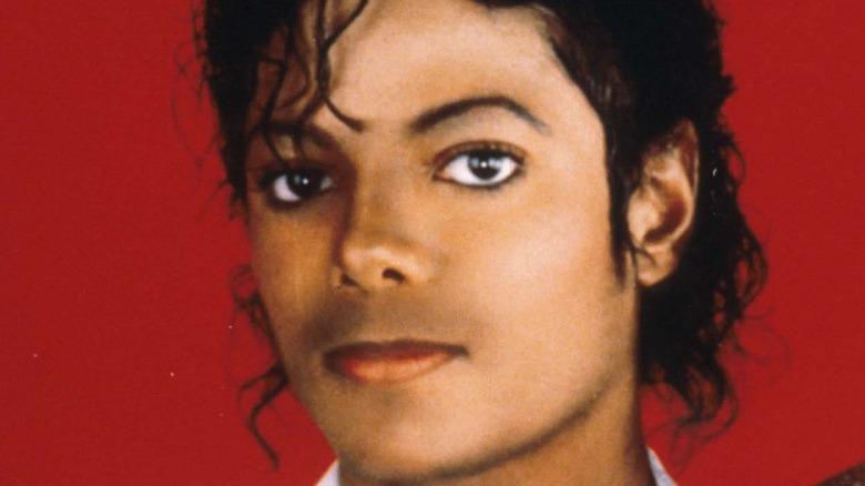 1987 Michael Jackson holding snake