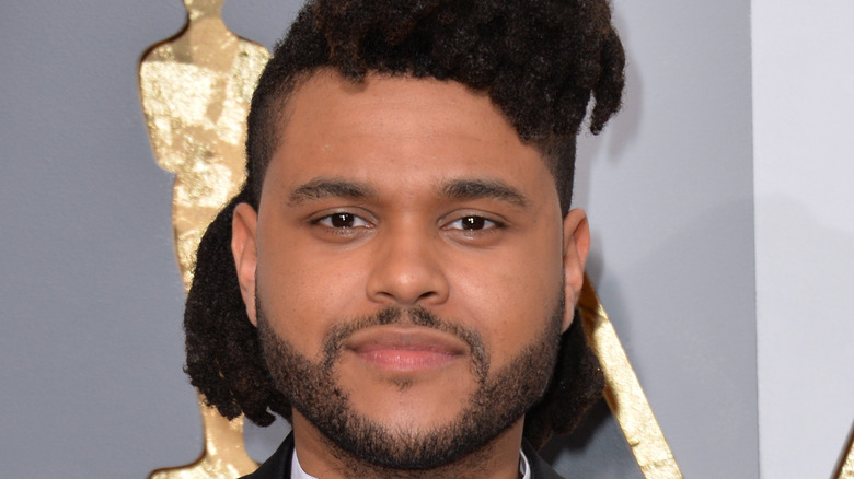 The Weeknd poses