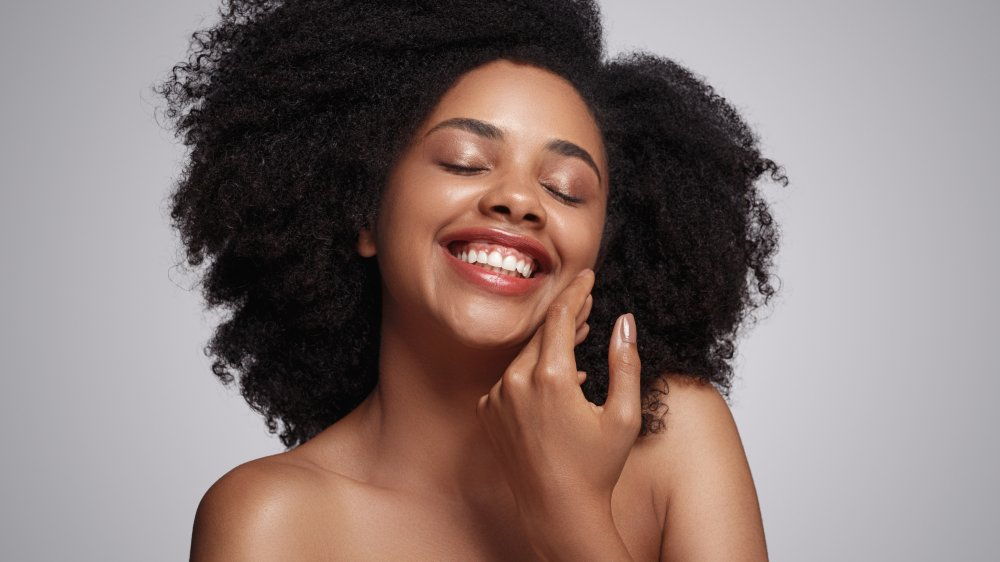 A woman with good skin, smiling